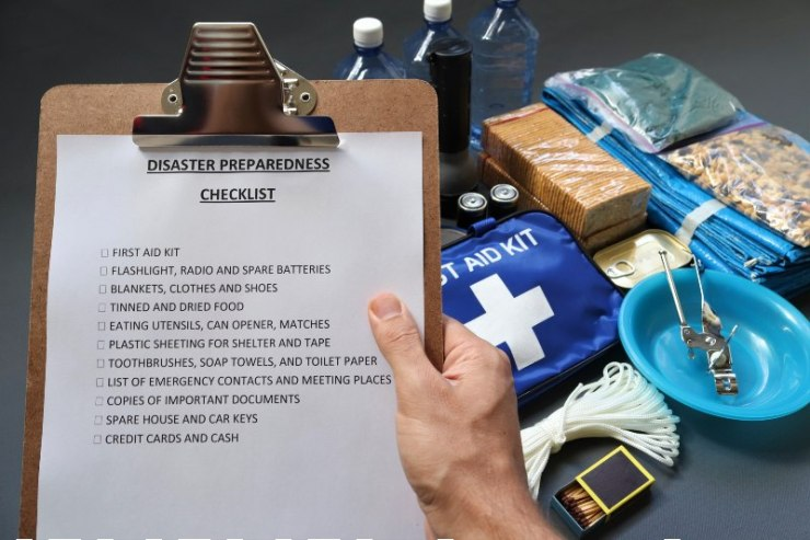 Disaster preparedness checklist on a clipboard with disaster relief items in the background-food kit-SS