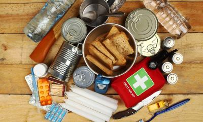 Items of emergency on wooden table-food kit-ss