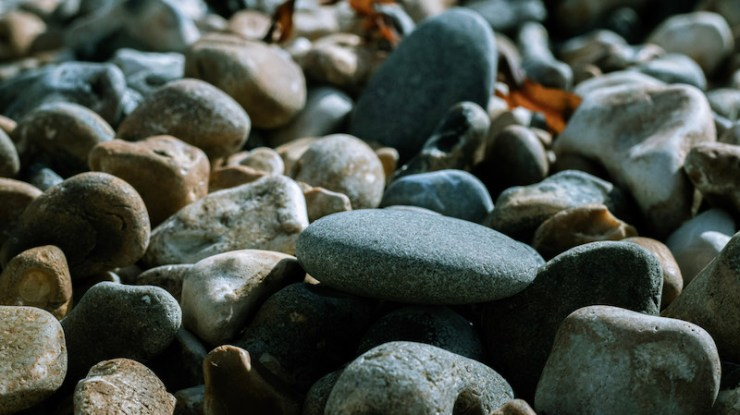 Stones on a pebble beach in Brighton | stone tools in human evolution