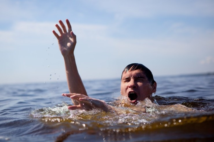 Seeking rescue. Man drowning in the sea trying to float-sea survival