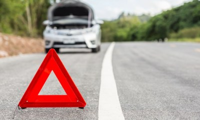 Red Emergency Sign and Broken Car on the Road | Car Emergency Kit | Featured