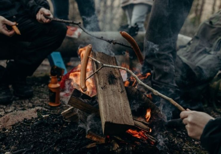 Selective focus photography of people holding sticks | Tips to Help You Camp in the Rain