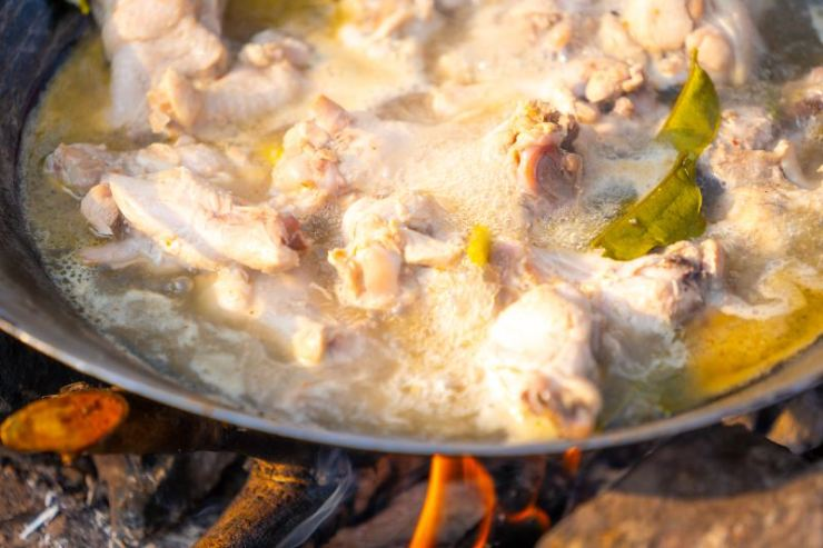 chicken spicy soup in pan on camping on hills-healthy camping meals