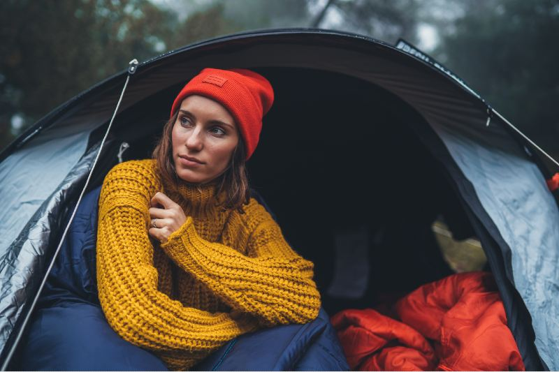 tourist traveler ralaxing in camp tent in foggy rain forest, hiker woman enjoy mist nature trip-Camping In The Rain