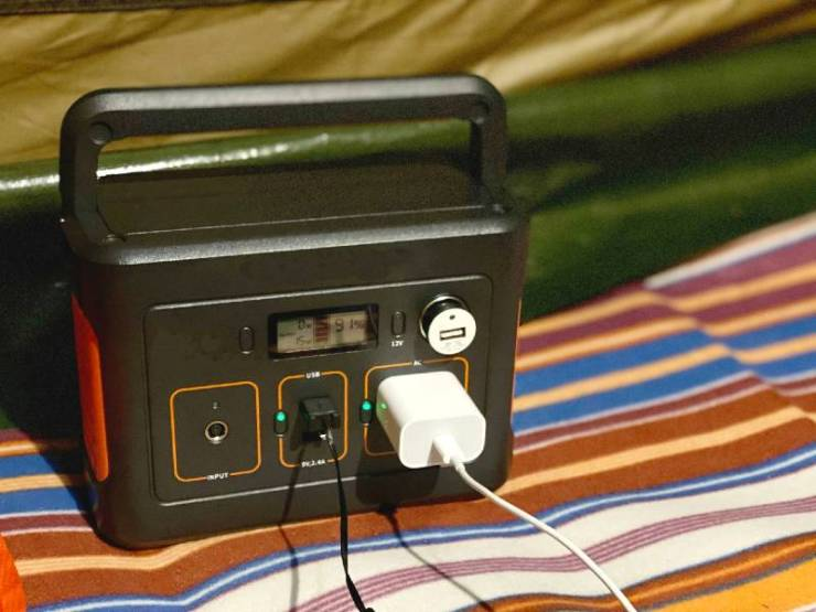 Charging-cord-plugged-into-a-portable-power-supply-Medical-Supplies