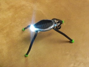 Nite Ize BugLit lit on table
