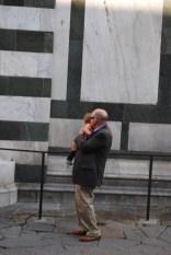 Grandpa loving on his grandbaby next to the Duomo