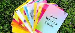 Soul wisdom cards fanned out on the grass
