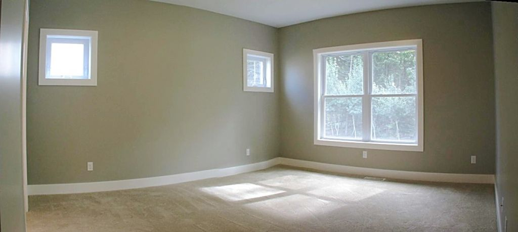 Large main level master bedroom with privacy windows.