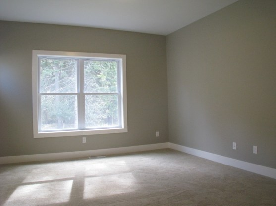 Main level master bedroom with great view of wooded yard.