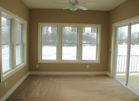 4-season room with lighted ceiling fan
