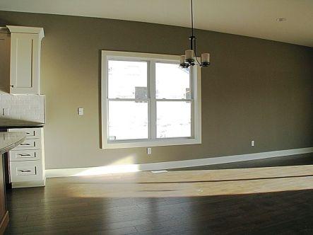 2447 Nuttall Court-Dining room-Laminate wood floor-Chandelier lighting fixture