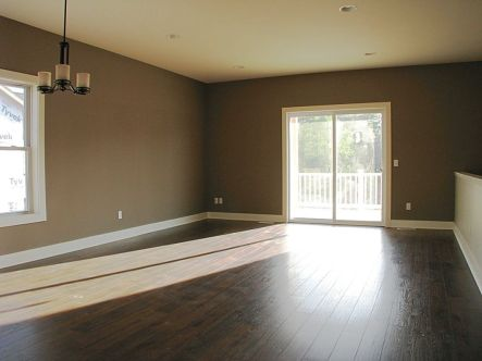 2447 Nuttall Court-Living room with laminate wood flooring-Slider to backyard deck