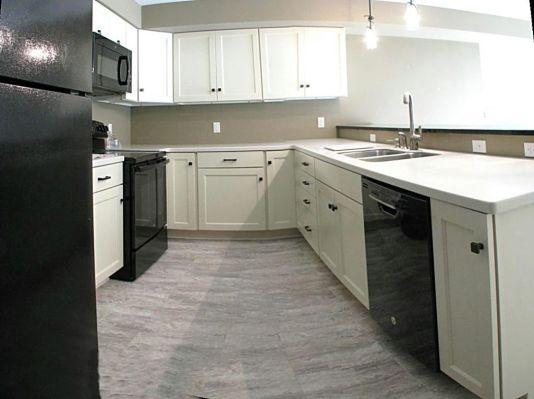 2447 Nuttall Court-Kitchen in lower level-Black appliances-White cabinets