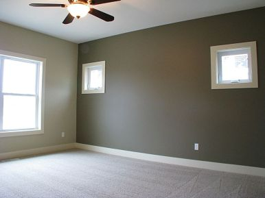 Master bedroom with lighted ceiling fan