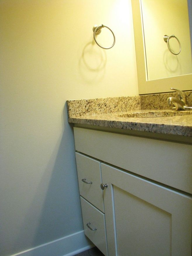 Hard surface counter on the vanity in the master bath