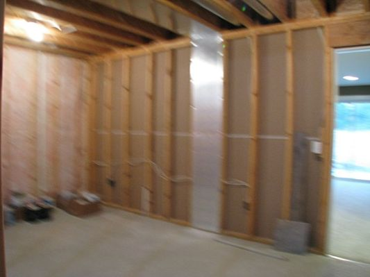 Another view of unfinished lower level storage room