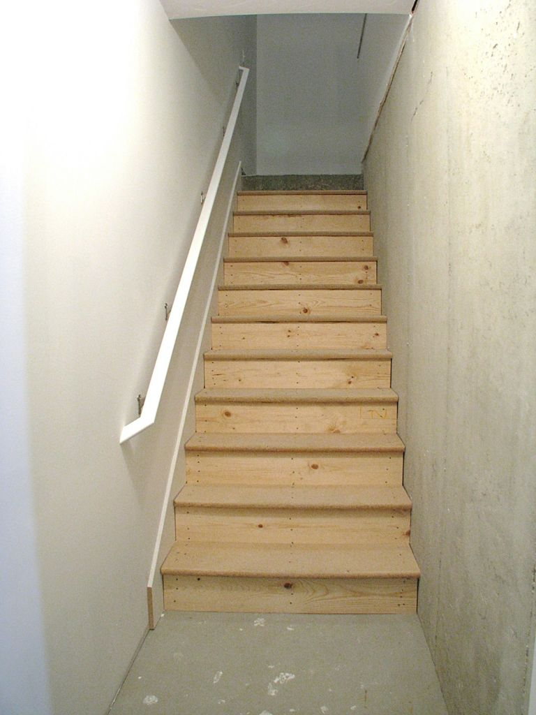 Close up of stairway from lower level to garage