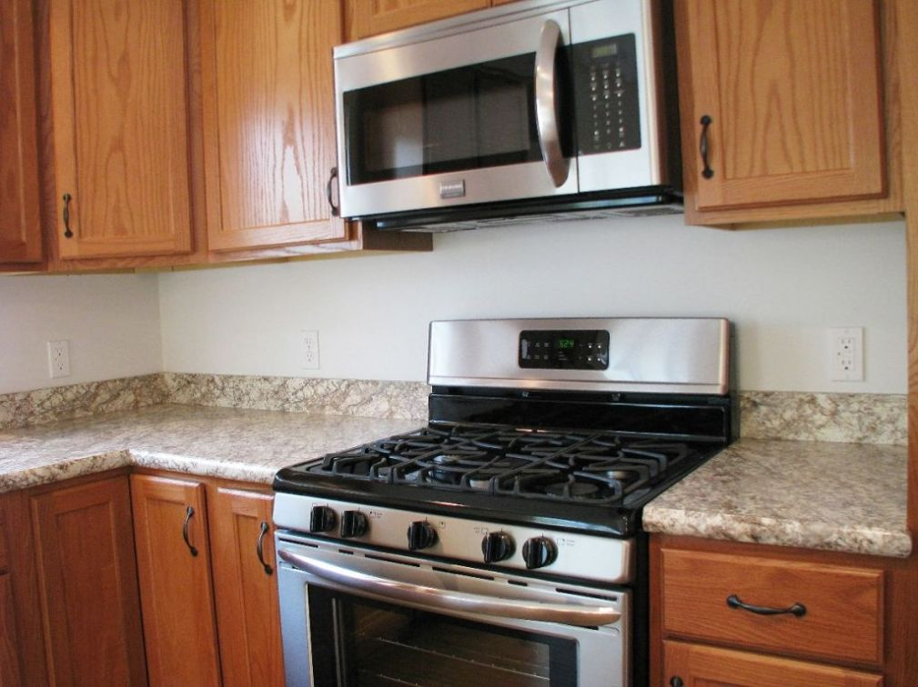 2444 Kitchen gas range with built in microwave