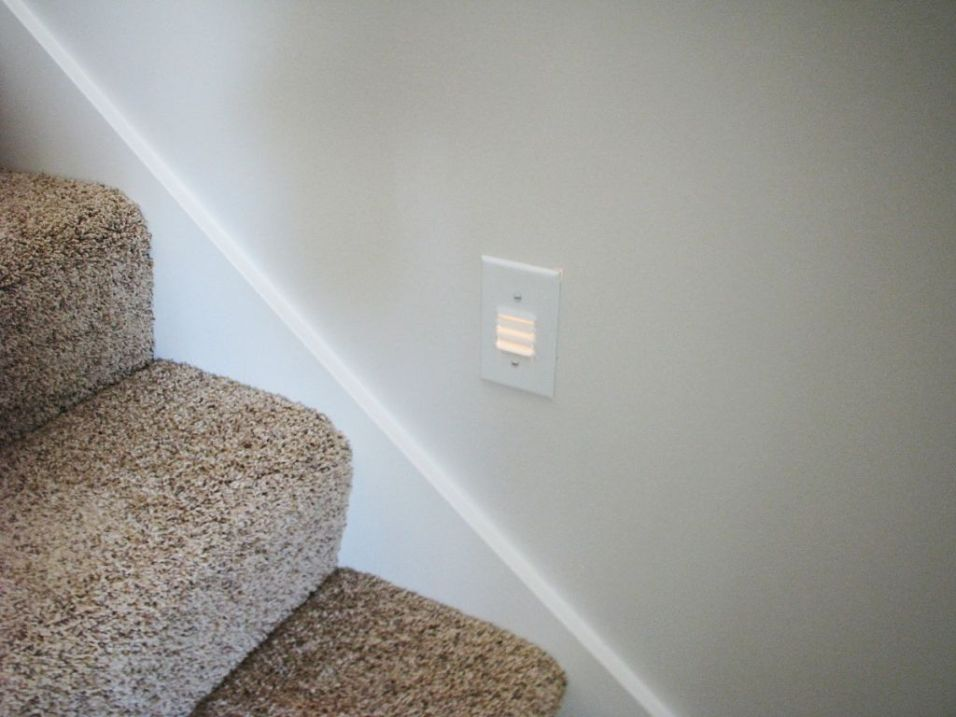 2444 Stairway from living room to lower level showing stairway lighting