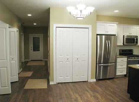 Foyer leading to kitchen.
