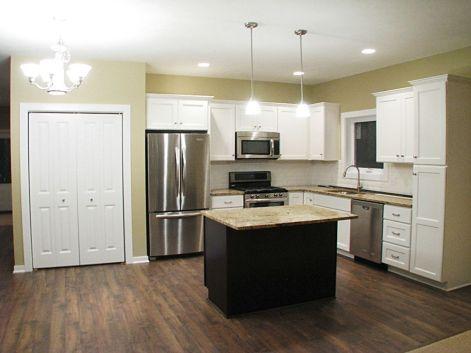 Kitchen with laminate wood flooring.