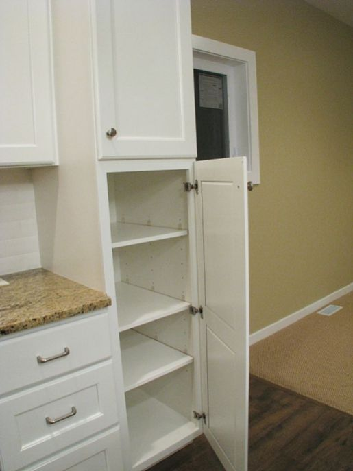 Kitchen cabinets with pantry.
