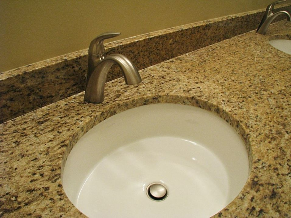 Sink on counter in master bath with high rise faucet.