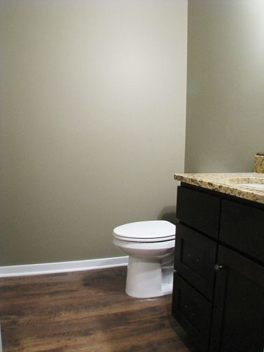 Half bath with elongated tolet.