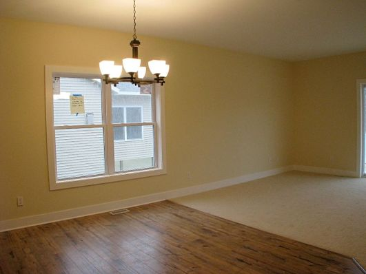 2433 Dining room with laminate wood floor and hanging light ficture