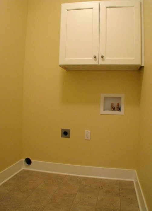 2433 Laundry with storage cabinet and hanging clothes bar