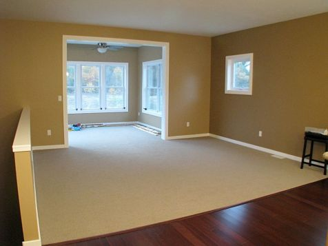 View of 4-season room and carpeted living room