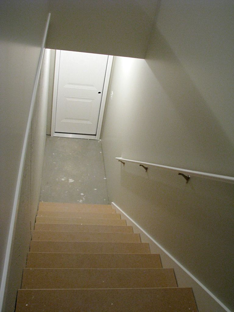 2433 Stairway from garage to lower level with door access