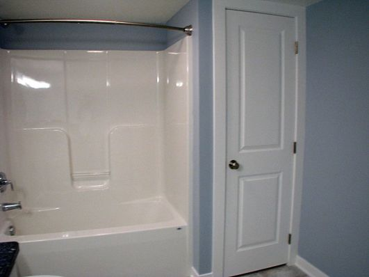 2437 Lower level one piece tub-shower combination