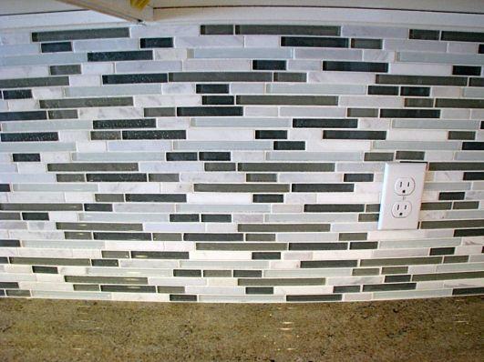 2415 Glass tile backsplash under cupboards