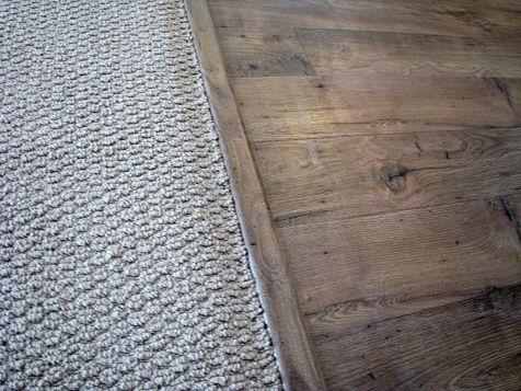 2415 Looped pile carpet joining laminate wood floor