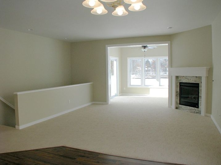 2518 Living room, Open stairway to lower level on left & 4-season room in background