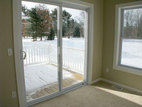 2518 Glass slider in 4-season room to back yard deck