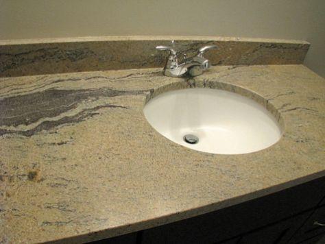 2415 Sink, water faucet, granite counter on lower level full bath vanity