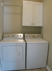 2518 Laundry, washer & dryer, storage cabinet, hanging clothes bar