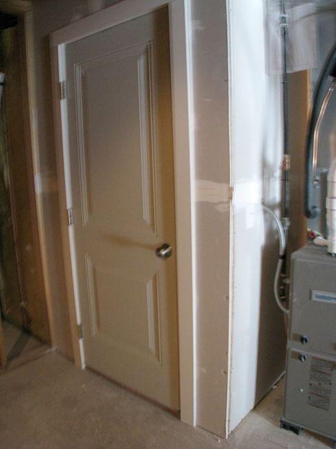 2415 Door to stairwar from lower level to garage