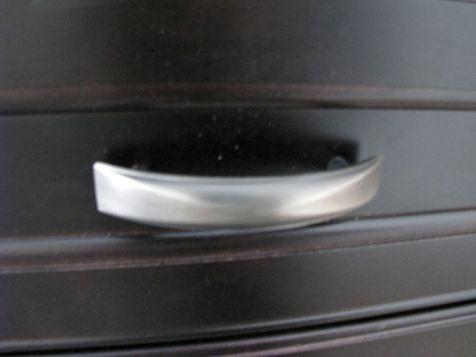 Brushed nickel handle on center island drawers