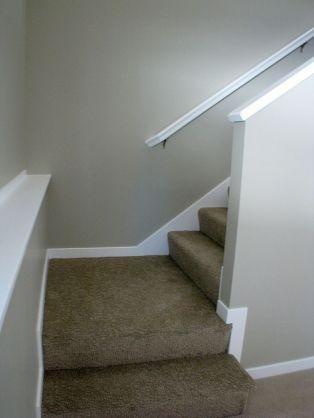 Landing at bottom of stairway