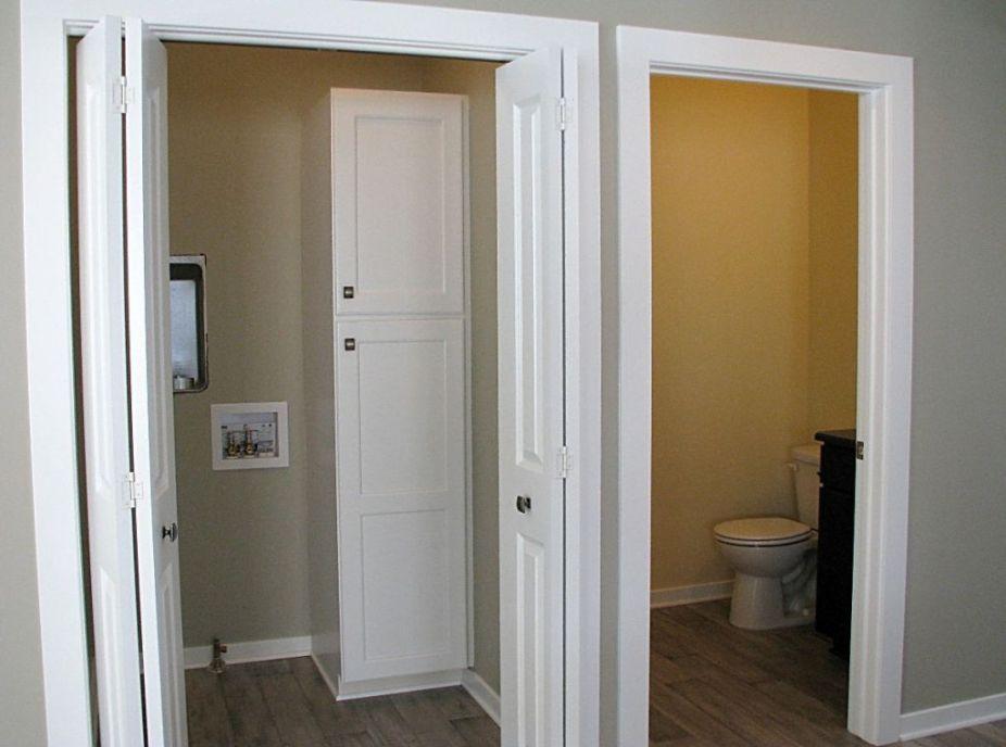 Doors to half bath and laundry