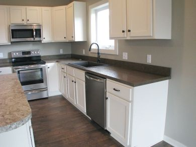 View of kitchen cabinets.