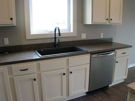 View of sink area and dishwasher