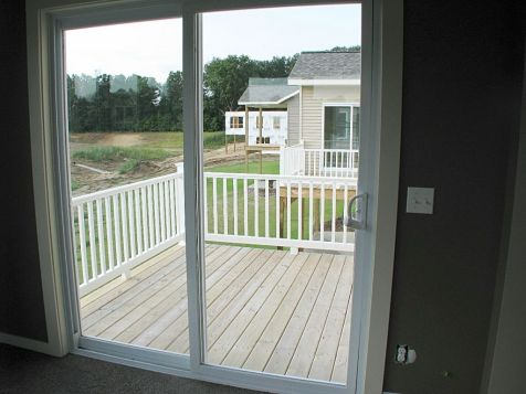 View through the 4-season room sliders to deck.