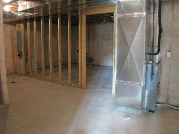 Unfinished storage room in lower level.
