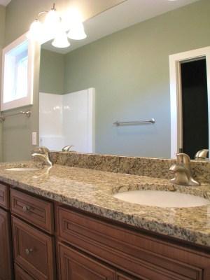 cabinet med brown and granite