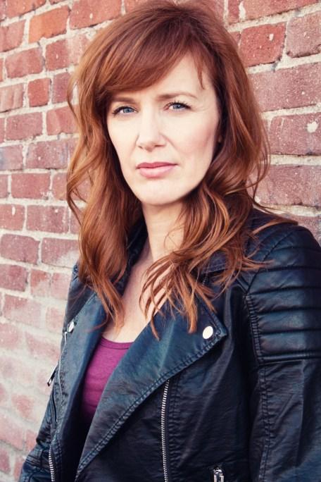 Susan-long hair against brick wall